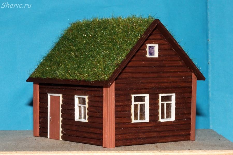 скандинавский домик с травой на крыше